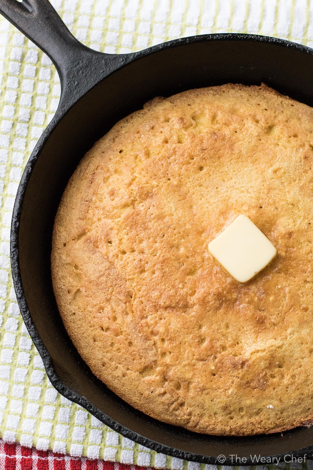 Southern Cornbread is tender and savory, not sweet like cake. This easy southern cornbread recipe is perfect with beans, BBQ, or soup!
