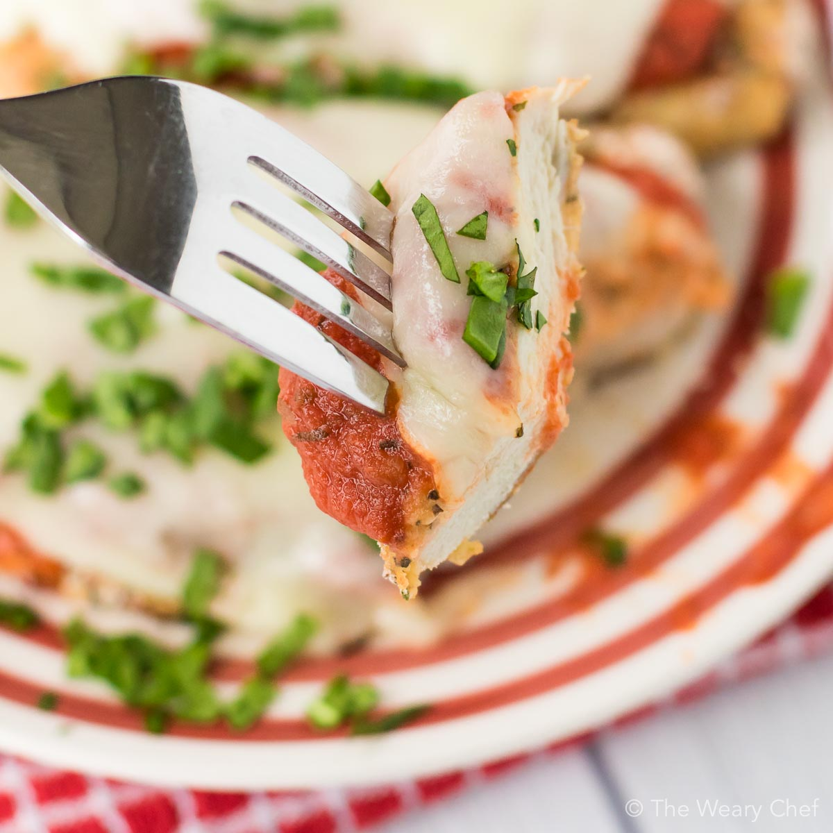 This Baked Chicken Parmesan is healthier, easier, and less messy than the classic version. Your family or guests will love this easy Italian dinner recipe!