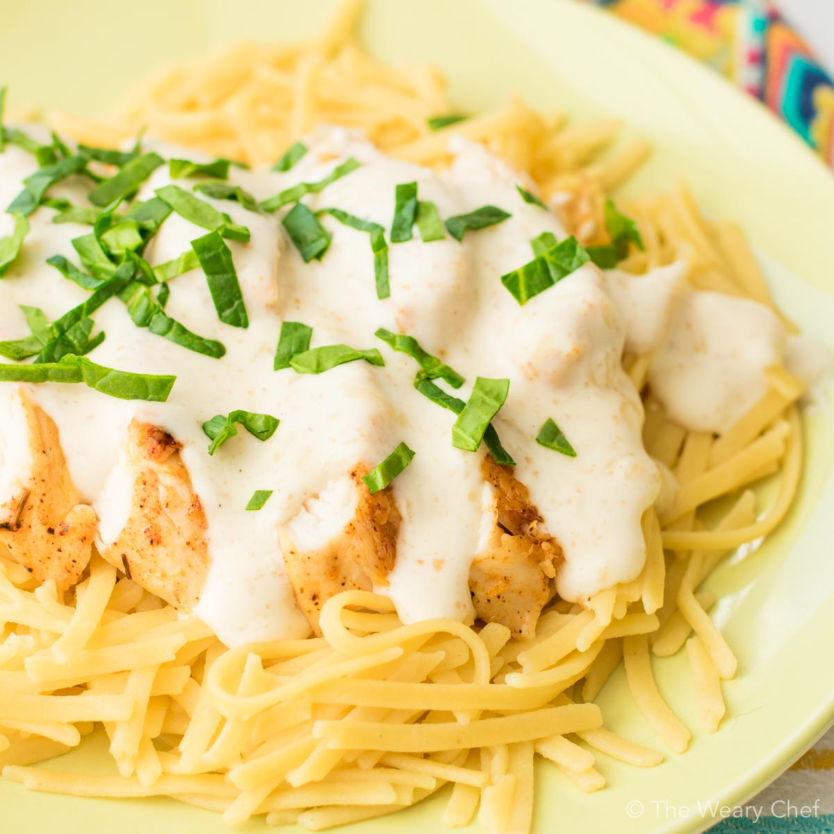 This lightened up chicken alfredo pasta is easy to prepare. It's perfect for special occasions or weeknight family dinners!