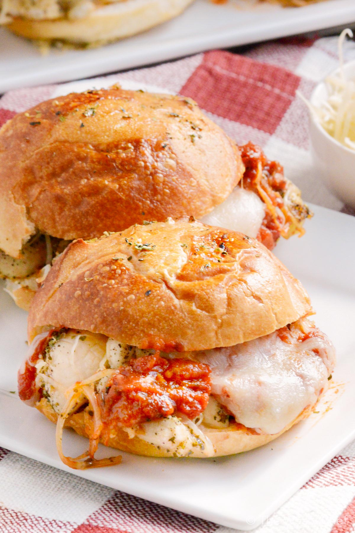 These Italian chicken sliders taste like chicken parmesan on a bun. They are ready in about 20 minutes and are a perfect family dinner recipe!