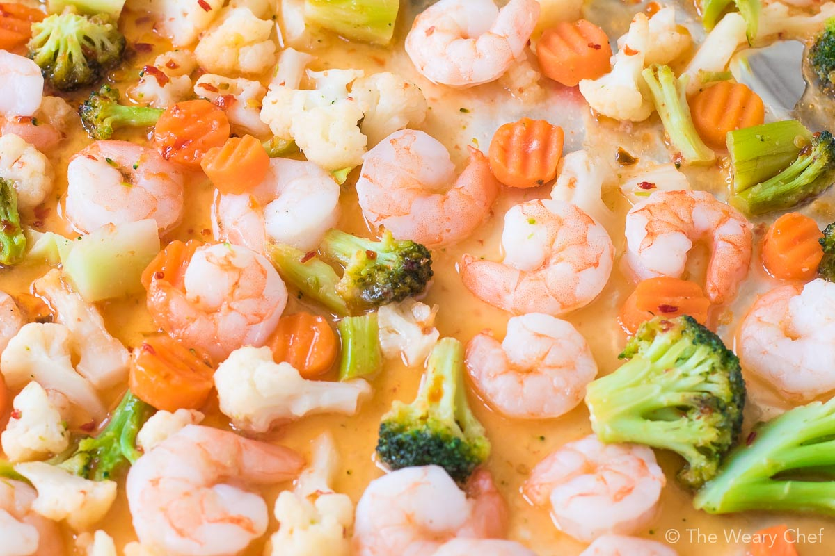 This 3-Ingredient Sweet Chili Shrimp Sheet Pan Supper could not be any easier! Just stir, cover, and bake. No thawing required!!