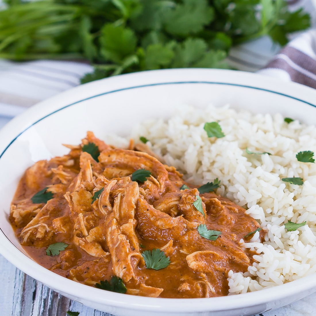 Whether you call it butter chicken or tikka masala, you are going to love this easy, flavorful slow cooker recipe! It's the perfect weeknight meal with very little hands on cooking time!