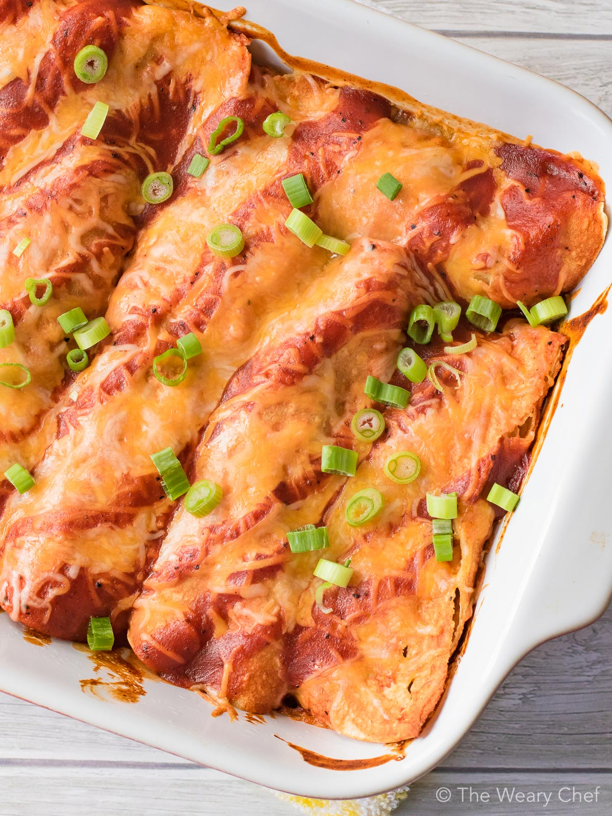 BBQ Brisket Enchiladas are the best way to enjoy your leftover brisket this Fourth of July! Make a low and slow beef brisket this weekend, and use the leftovers in this fast weeknight recipe.