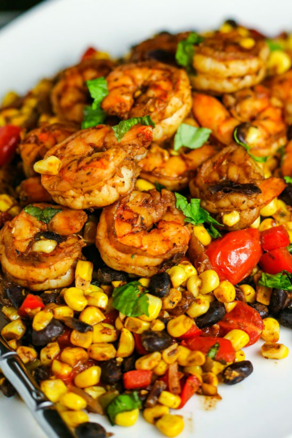 Southwest Shrimp Succotash made with fresh corn and black beans is a fresh, healthy, and easy dinner you can make in one skillet!