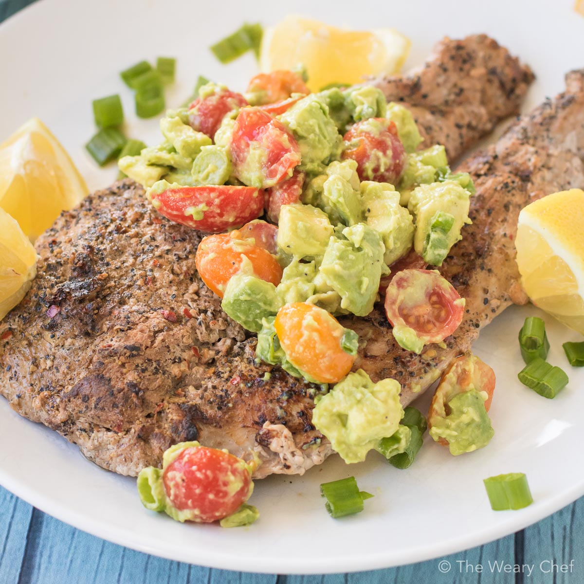 This butterflied pork tenderloin is grilled to perfection and then topped with a quick and easy lemon avocado salsa. This dinner is ready in under 30 minutes and is full of flavor!