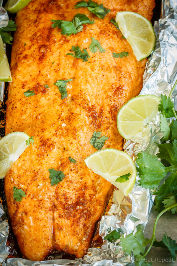 Learn how to bake salmon in foil with lime and chile for a tasty 30 minute meal that the whole family will love! #salmon #sheetpan #seafood