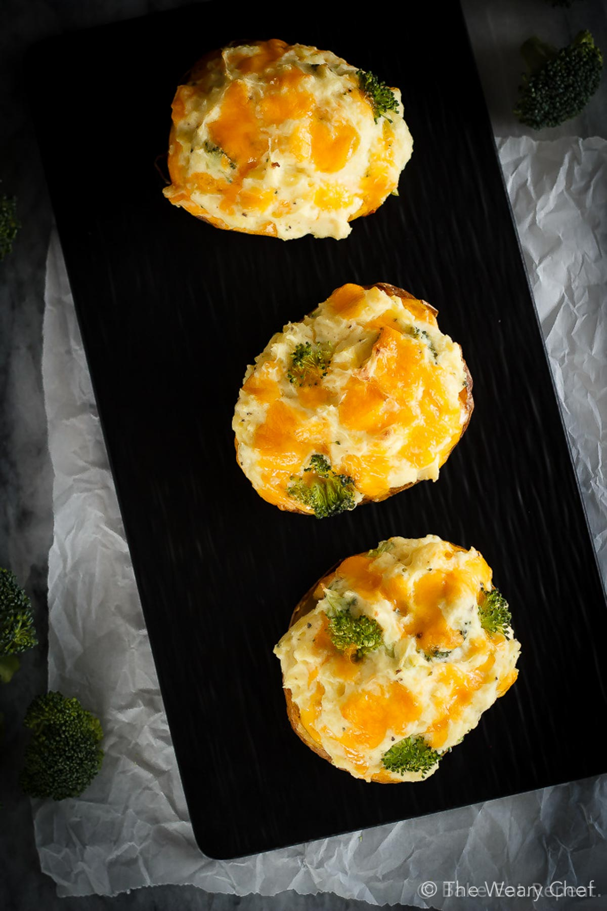 These twice baked potatoes filled with cheddar cheese and broccoli are the perfect side dish - they're easy to make and the whole family will love them! #bakedpotatoes #stuffedpotatoes #broccoli #cheddar
