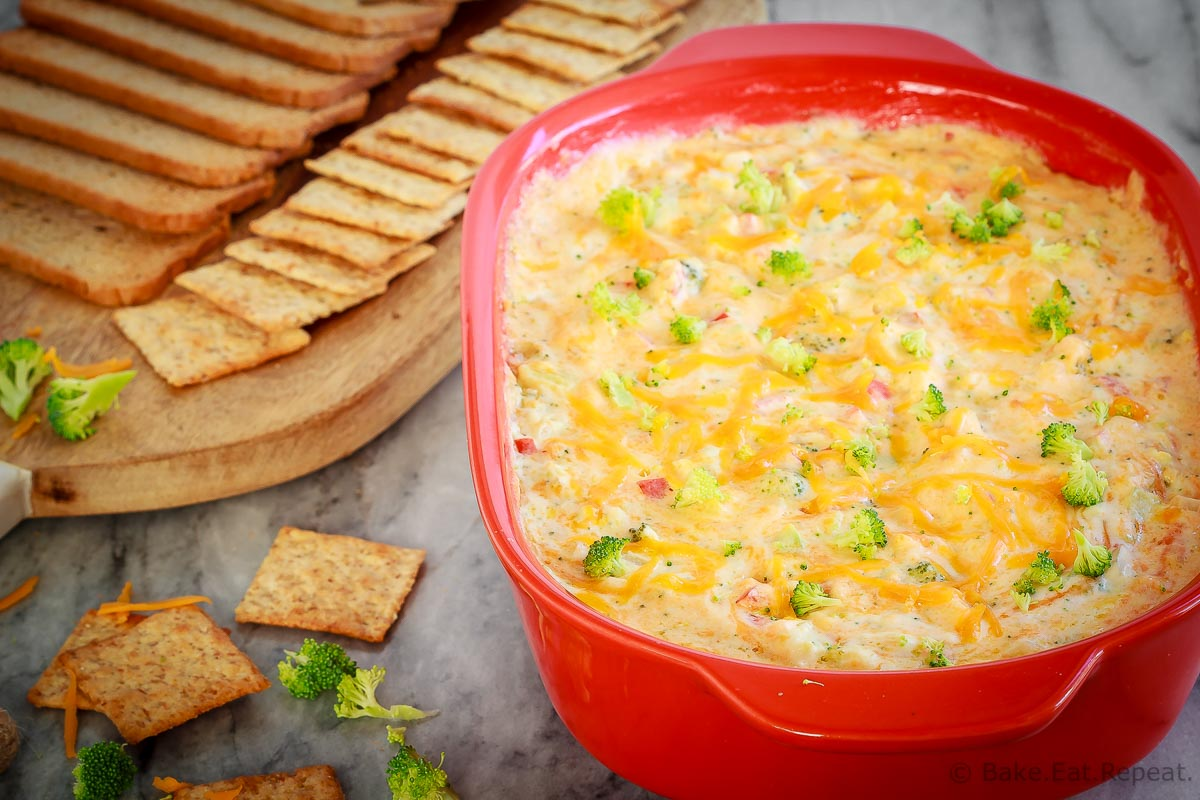 This hot, baked broccoli cheese dip is easy to mix up and can be made ahead of time. Everyone will love this appetizer served with crackers, chips or veggies! #dip #broccoli #cheese #cheddar #appetizer