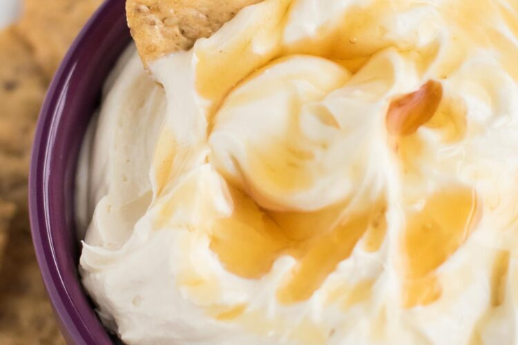 Looking for an easy appetizer to serve at your next party? This Honey Whipped Goat Cheese Spread is IT! All you need is tangy chevre, rich cream cheese, and sweet raw honey.
