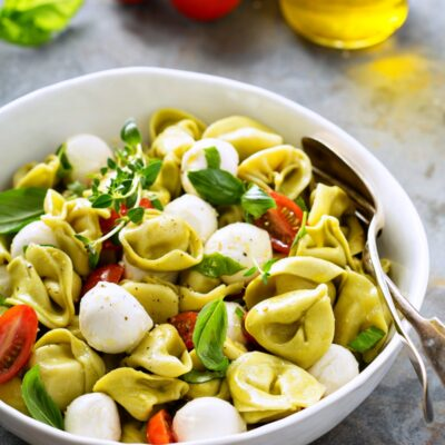 This fresh, easy, and filling Tortellini Pasta Salad with Caprese flavors makes a quick dinner or side dish! #tortellini #pastasalad #vegetarian
