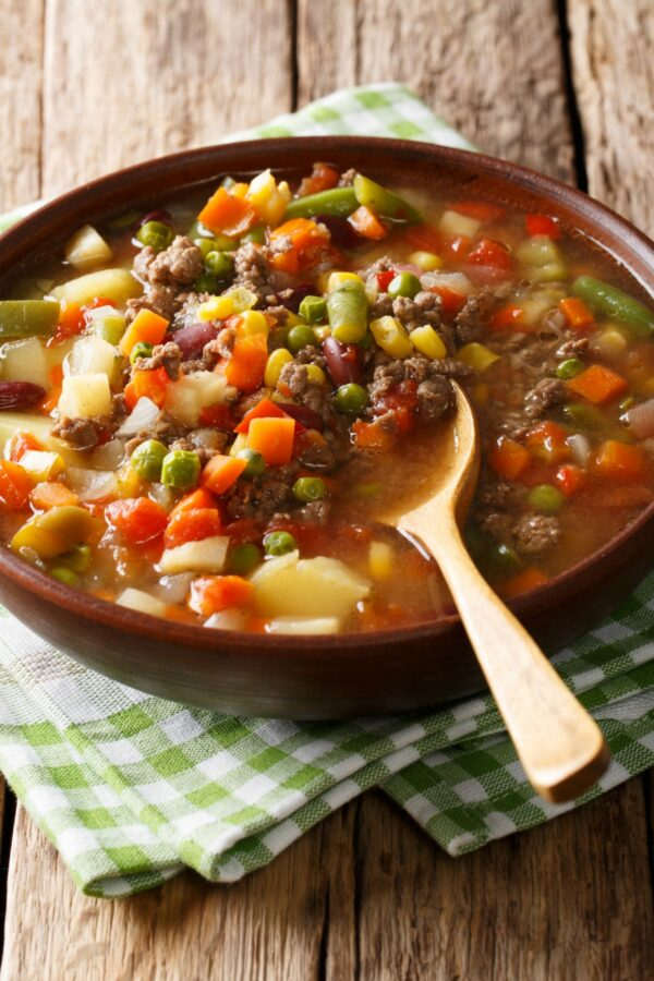 This easy hamburger soup is loaded with ground beef and vegetables. Make it in the slow cooker or in about a half hour! #beef #soup #vegetables #healthy