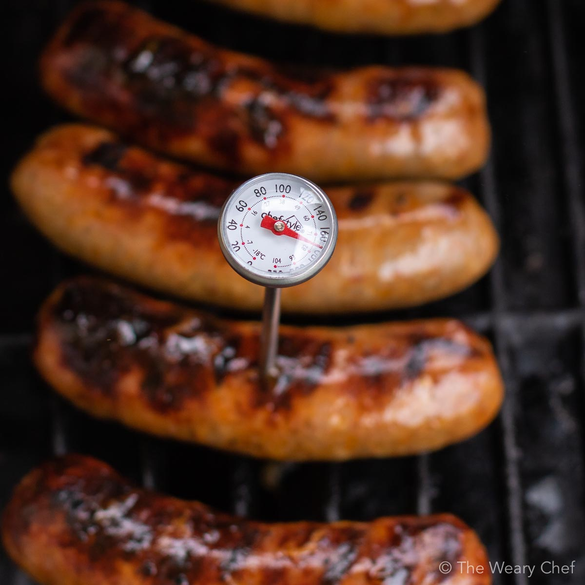 Grilled Sriracha Peppers and Onions with Sausages are an easy meal for summer entertaining! #grill #sausage #sriracha #spicy #peppers #thewearychef