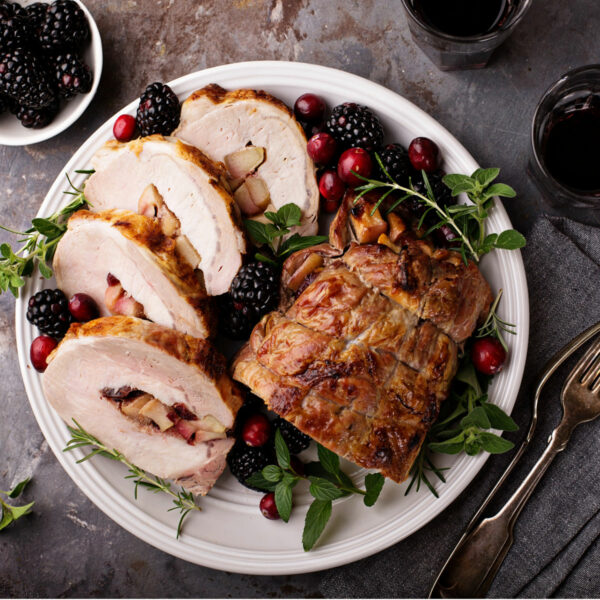 This beautiful Apple Cranberry Stuffed Pork Tenderloin only needs a few ingredients and is perfect for holiday meals. #pork #cranberry #apple #dinnerrecipe #holidayrecipe