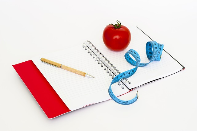 tape measure, pen and notebook which can help you monitoring your weight