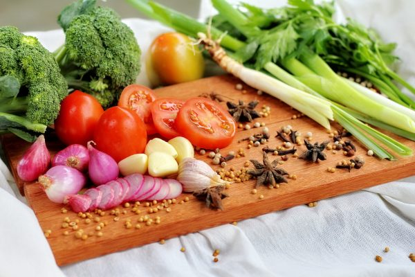 A cutting board with a variety of vegetables