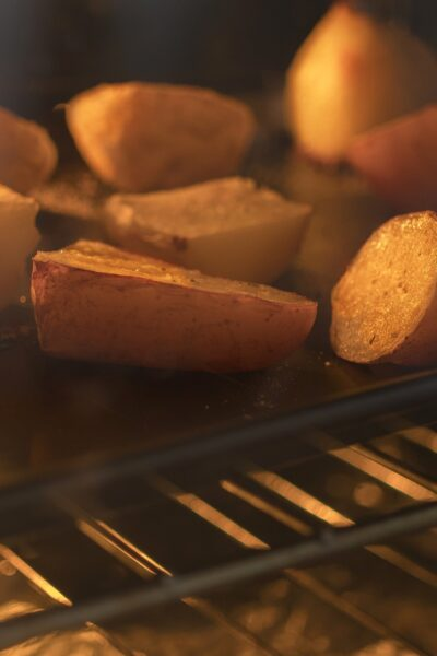 Potatoes in an oven as part of a sheet pan dinner recipe