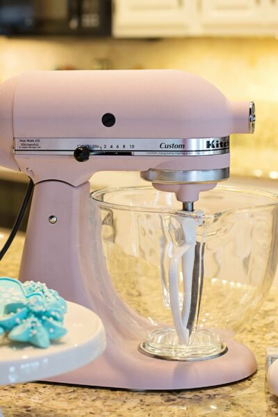 Cookies and a pink mixer with Kitchenaid Food Processor Attachments